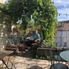 Having afternoon tea in the garden of an English bookshop in Montcuq